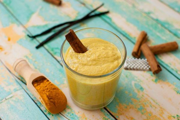 healthy smoothie with turmeric, vanilla, cinnamon and coconut milk