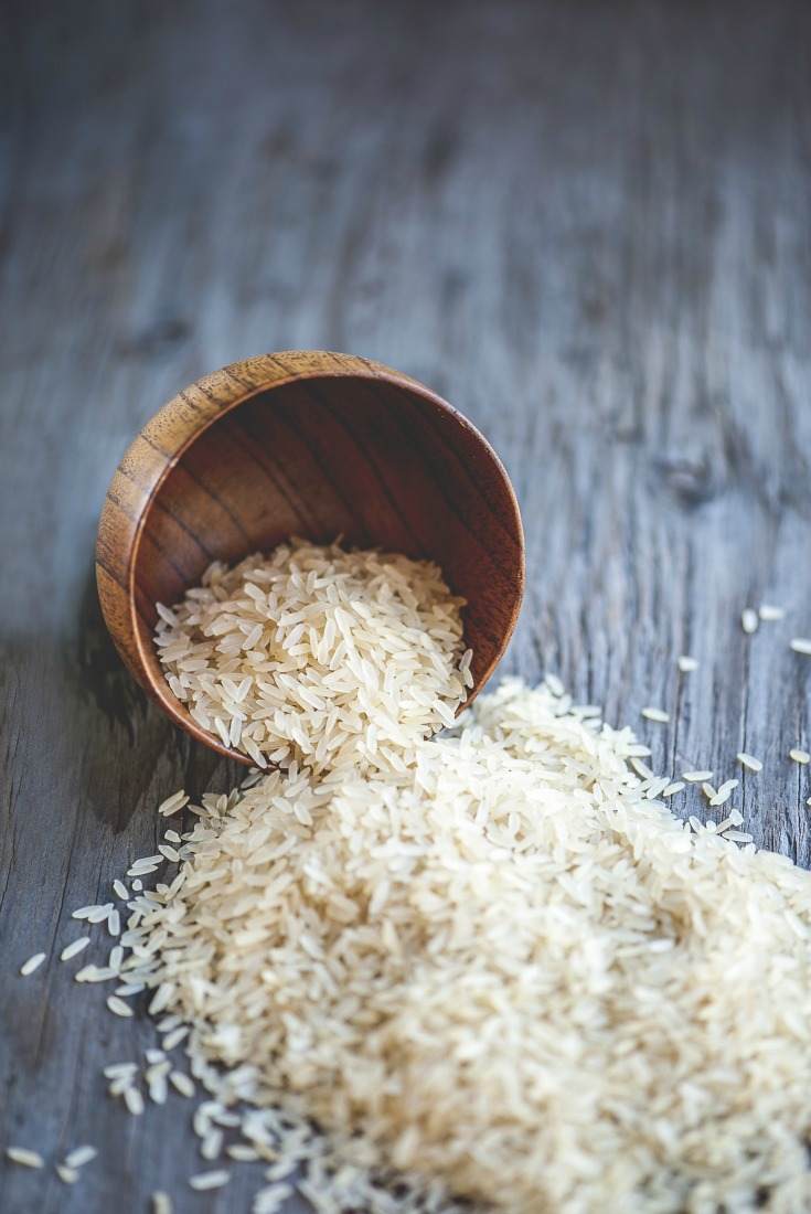 Close-up view of rice bowl on rustic wooden table, shallow DOF